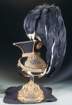 Queen's Royal Lancers Officer's Czapka with an Additional Cap Plate This is a Victorian era officer's lance cap for the 9th Lancers. The skull, peak and top are composed of black patent leather.