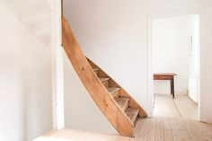 a gently curved staircase, fmm-architekten-wood-staircase-remodelista Interior Desing, Interior Architecture, Curved Staircase, Spiral Staircases, Wooden Stairs, Timber House, House Stairs, Attic Stairs, Foyers
