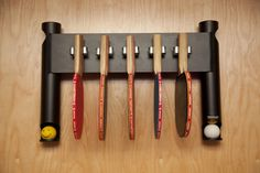 Pongon Wall-mount table tennis / ping-pong paddle and ball-holder.  Store your 40mm balls, hang up to 5 paddles in clip holders and store up to 2 paddles in bags for easy storage and retrieval.