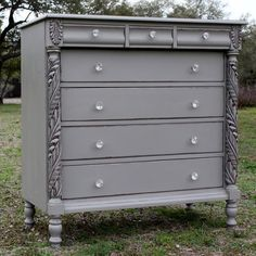 This dresser has a great silhouette and gorgeous carved details.  We painted it with Annie Sloans French Linen which is a cool khaki gray. It was distressed just enough to highlight its lovely details. We updated the piece with clear glass knobs.