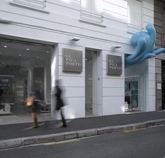A Splash Of Water Passes Through The Window Of This Storefront