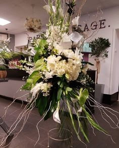 A free standing extra large and extra lush sympathy floral arrangement that was inspired by an American design for a very glam and loved lady