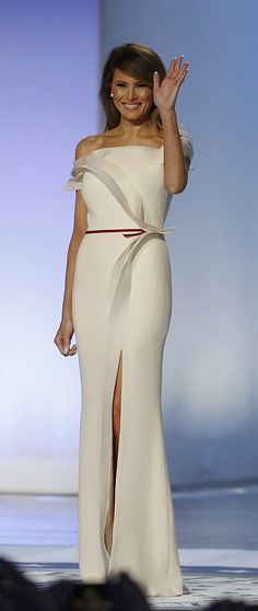 The first lady wore a white gown she co-designed with Hervé Pierre, one of Carolina Herrera's former staff