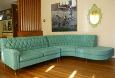 Love this vintage tufted turquoise sectional sofa!