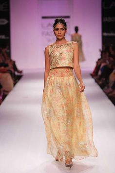 Floral crop top lehnga by Zara Shahjahan at Lakme Fashion Week Winter 2014. More here: http://www.indianweddingsite.com/lakme-fashion-week-winter-2014-designer-zara-shahjahan/