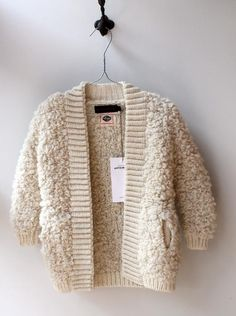 Fuzzy creme or beige cardigan sweater with pockets. Pinterest | @chelstokarski