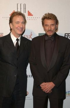 2002 - at the European Film Awards at the Teatro dell Opera di Roma, Rome Italy. Alan Rickman is on the left - Johnny Hallyday is on the right.