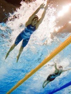Rebecca Soni.  Look out those pointed toes. I feel a breaststroke kick coming on.