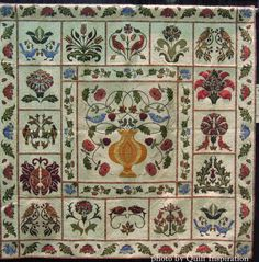 """Nature's Treasures by Diane Abram (UK).  """"Best of Country"""" at the 2015 World Quilt Show. William Morris designs by Rosemary Makhan (center) and Michele Hill (floral blocks)  Photo by Quilt Inspiration."""