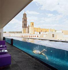 Glass-sided lap pool at La Purificadora Hotel; Puebla, Mexico