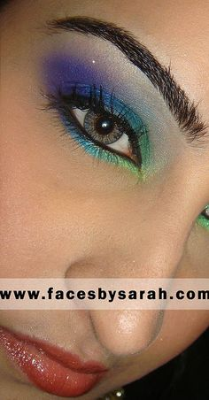 peacock makeup. Use more orange and blue. And softer look