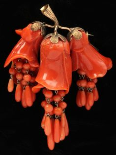 Antique Carved Red Coral Brooch the finely carved floral brooch designed as three stylized trumpet flowers with beaded drops