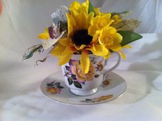 Tea cup floral arrangement  on Etsy, $25.00
