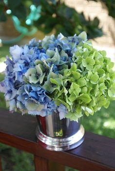 Blue and green hydrangeas in a tumbler can freshen any room.
