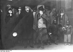 """Zoo Director Ludwig Heck, meeting members of the African Sara Kaba tribe at the Anhalter Bahnhof Station in Berlin, 1931. Incorrectly referred to as """"Ubangi,"""" the Sara Kaba were to be showcased at the Berlin Zoo as part of a Human Zoo exhibit."""