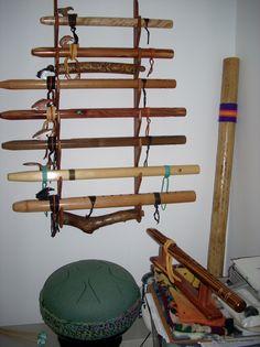 flutes, rain stick and steel tongue tank drum. Rain Sticks, Native American Flute, Activists, Flutes, Native Art, Drum, Wine Rack, Authors, Feathers
