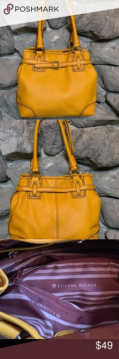 "Etienne Aigner Leather Handbag Talk about a pop of color! Style this with lush Autumn tones or pop it with your Summer whites! Used once - pristinely clean top, bottom, inside and out! 21"" inch straps long enough to fit over your shoulder but short enough to carry as a small tote. Antique gold tone buckles, grommets and snaps. 2 zipper inside sections for secure items and 3 smaller side pockets for sassy sunglasses and iPhones. Bottom panel measures 4.5 x 10.5 - large enough to haul all that is"