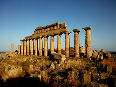 """Selinunte (Ancient Greek: Σελινοῦς; Latin: Selinus) was an ancient Greek city on the southern coast of Sicily in Italy. It was situated between the valleys of the Belice and Modione rivers. It now lies in the comune Castelvetrano, between the frazioni of Triscina di Selinunte in the west and Marinella di Selinunte in the east. The archaeological site contains five temples centered on an acropolis. Of the five temples, only the Temple of Hera, also known as """"Temple E"""", has been re-erected."""