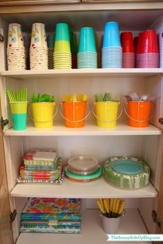 organized laundry room (party supply cupboard) - LOTS of organizing ideas in this post (Sunny Side Up)