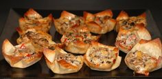 Sausage stars - wanton wrappers in cupcake tins filled with sausage, cheese, ranch and black olives.