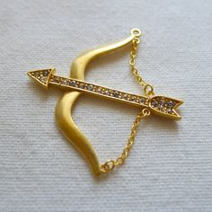 Bow and Arrow Pendant, Gold Plated. $7.90, via Etsy.