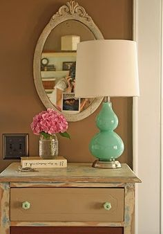 Mint lamp on the distressed table, with a Pretty cream mirror