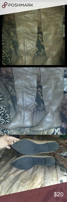 Cupid Over the Knee Boots In fantastic condition! Extremely comfortable, no slipping or problems with them staying up. They are strong enough to stay in place, but pliable enough to move with the curves and movement of knees/thighs/feet. There is also elastic in the area where knees bend. Zipper and elastic for easy on/off. Really great boots, it'll just be so long before I 'm able to wear them again. Cupid Shoes Over the Knee Boots