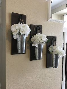 This listing is for a farmhouse inspired set of 2 or 3 Hanging Galvanized Vase Sconces. They are the perfect addition to a your home decor!! They are 14 tall and 5 wide. Scroll through the listing to see all of your wood finish options. Your will select your finish at checkout.