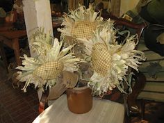 ANTIQUES IN OLD TOWN Cute sunflowers with corn husk petals!