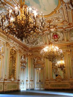 This room has the Rococo style because of the elegant features and the pastel and gold colors. along with the paintings in between parts of the elaborate wall pieces.