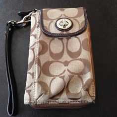 ❤️Final Price❤️Coach Monogram Wristlet Good condition, classic monogram print with brown leather trim, outside cell/eyeglass case, exterior four card/id slots, eight additional interior slots, zipper change section. Tan interior. Coach Bags Clutches & Wristlets