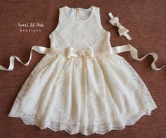 Gorgeous Ivory Lace Girl Dress with ivory satin bow sash and headband embellished with pearls! Beautiful flower girl lace dress made with very soft and delicate lace! The dress is lined inside and is not see through at the bodice. Made with Love for your Sweet Lil Posh this Stunning Ivory Lace Dress is perfect for Summer, Birthday, Tea party, Flower Girl Dress, 2nd Birthday photos, Christening, Communion, Junior Bridesmaid, Vintage, Country, Rustic wedding, or any special occasion! SET…