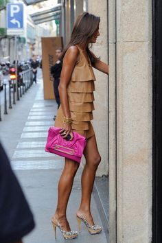Brazilian model Magda Gomes - nude ruffled leather dress