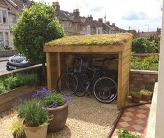 Bristol bike shelter with sedum blanket in the green roof planting area. Front g… Bristol bike shelter with sedum blanket in the green roof planting area. Front garden of a Victorian terraced home. Garden Bike Storage, Outdoor Bike Storage, Bike Storage Roof, Victorian Front Garden, Victorian Terrace, Pergola Shade, Diy Pergola, Pergola Kits, Pergola Ideas