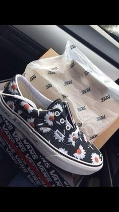 shoes vans black and white daisy vans vans of the wall floral fashion flowers flower pattern #flowers black romper party outfits short aztec navy high heels cute hand bag print vintage