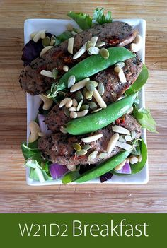 June 27th 2013 - W21D2 Breakfast - Organic chicken sausage, sugar peas, leafy greens, almonds, pine nuts, pumpkin seeds.