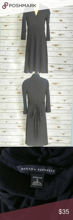 Banana Republic Navy Stretch Wrap Dress Banana Republic Navy Stretch Wrap Dress  Size S in excellent condition. Bow tie back that cinches at the waist. Nice soft material, perfect career piece. Throw this on and you won't need anything else! Banana Republic Dresses Long Sleeve