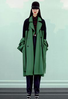 Green coat with black inserts. By Kenzo