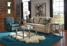 The Claudine sofa features arms that flare outward and wrap up around the entire back giving it a warm and embracing presence.