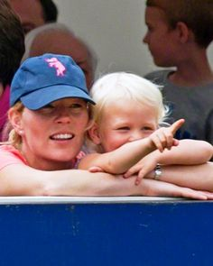 Autumn Phillips and daughter Isla watch the bike stunt by Australian Matt Coulter at the annual Gatcombe Horse Trials on Princess Anne's Gatcombe Estate