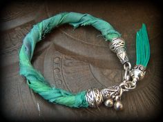 Sari Silk Leather Cord Bell CharmsTassel Bracelet by YuccaBloom