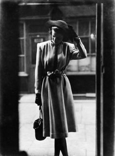 Fashion study in doorway, March 1946.  Norman Parkinson