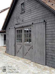 Sliding Barn Door Shutters - garage doors - by Real Carriage Door Company - July 14 2019 at Barn Door Garage, Exterior Barn Doors, Garage Door Windows, Exterior Windows, Patio Doors, Gray Exterior, Exterior Stain, Barn Siding, House Doors