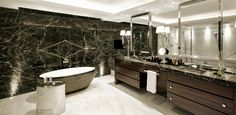Soak it up: the magnificent bathroom features an ample tub and mirrored wall that boasts marble surfaces and two sinks