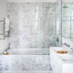 Sleek modern bathroom with marble tiling
