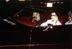 August 7, 1975: Elvis and his girlfriend Linda Thompson arriving in his Stutz Blackhawk at the Graceland gates (Looks like his cousin Billy Smith in the back.)