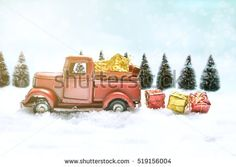 Red truck toy carrying a christmas gift on sweet pastel retro turquoise color background.