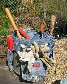 upcycled denim garden tool bucket caddy. I have wanted a bucket caddy and this would be perfect!! Also, good reminder that I could make a gardener's empty leg with, literally, a (pant) leg and the belt loops.