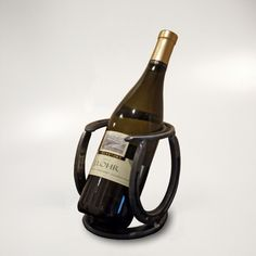 """Cradle to Grave"" Horseshoe Wine Rack to display the bottle you are drinking. From CarolinaWineRacks.com"