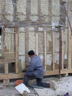 Chris repairing the wattle and daub infill